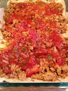 Layers: tortillas, meat, salsa