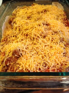 After 2nd layer of tortillas, add meat, enchilada sauce and more cheese